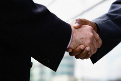 Businessmen Shaking Hands --- Image by © Corbis